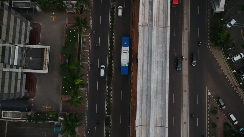 Jakarta, Indonesia - October 17 2018: Aerial view of railroad tracks construction for Light Rail Transit or LRT in Jakarta downtown. | Shutterstock HD Video #1019748316