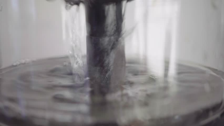 Water runs into the coffee machine, close-up | Shutterstock HD Video #1019794156