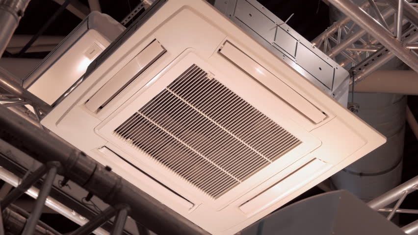 Powerful ceiling air conditioner on the ceiling of an industrial enterprise. Shot in motion  | Shutterstock HD Video #1019811256