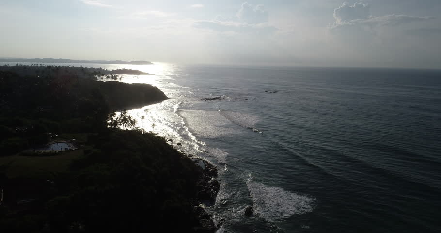 Aerial view.Drone ascent aerial footage of ocean waves and weligama cap in the sunrise landscape | Shutterstock HD Video #1019994136