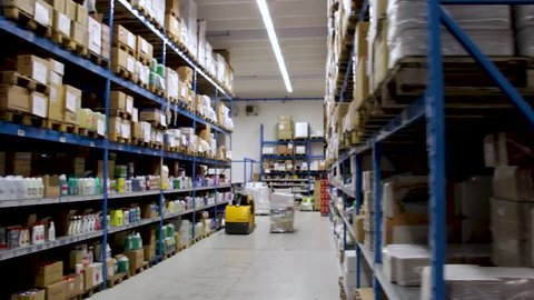 Long slider shot of a Food, Grocery and Households warehouse in Italy. Shelves full of stock