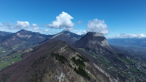 Chartreuse mountain from a drone view, aerial sunny day Grenoble town