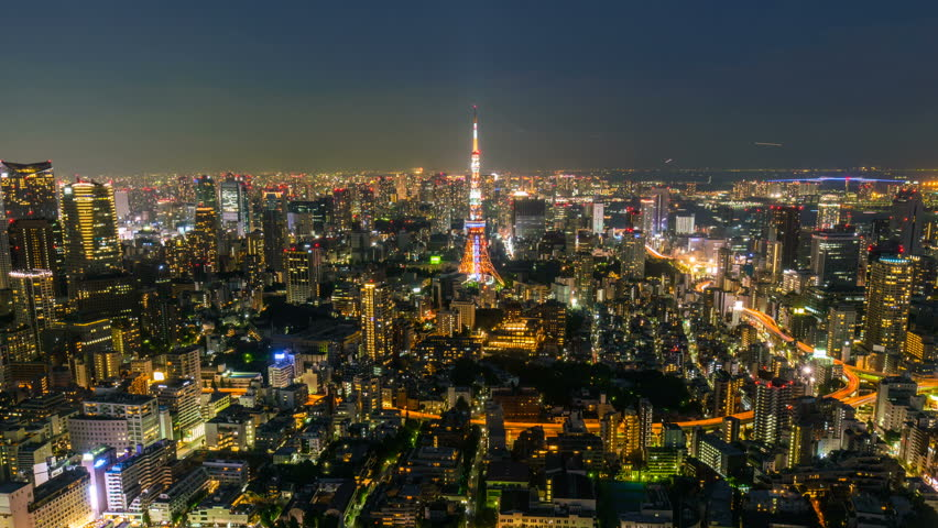 Timelapse Overview with tilt up motion of iconic cityscape in day to night transition in Tokyo, Japan | Shutterstock HD Video #1020043486