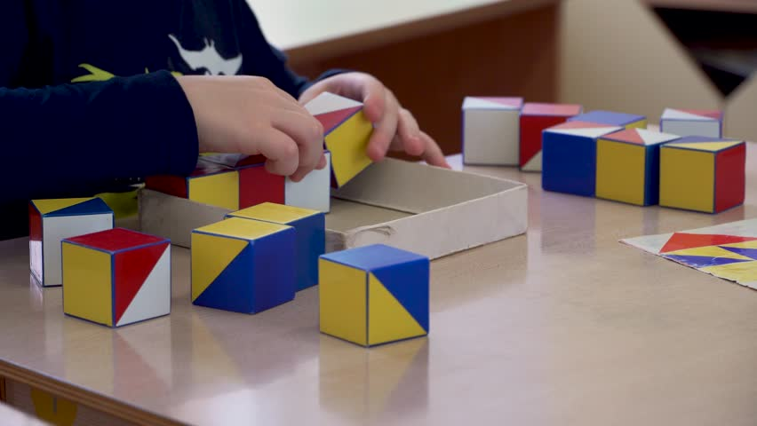 Children's hands are engaged in creativity. Colored cubes | Shutterstock HD Video #1020070546