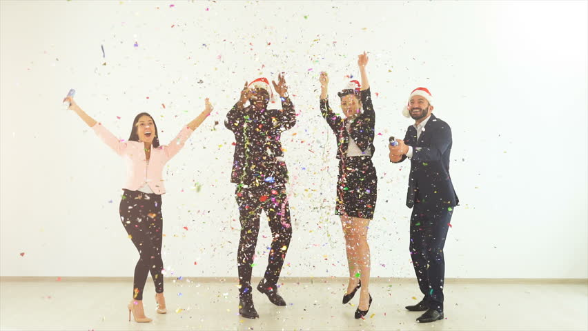 The four business people playing with confetti. slow motion | Shutterstock HD Video #1020139606