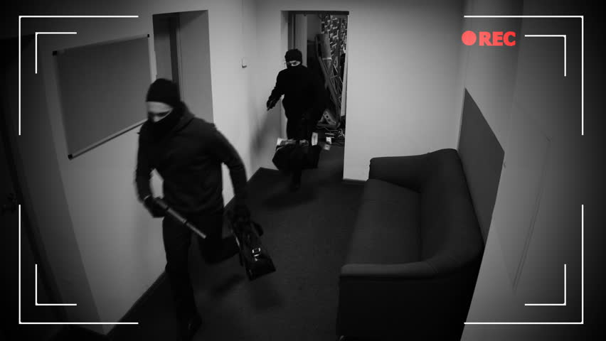 Masked thieves running off with begs of money, shooting in surveillance camera | Shutterstock HD Video #1020248086