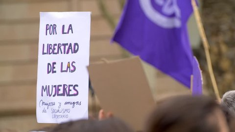 Poster with inscription in spanish. For women freedom. Feminist Activists in a Demonstration. March for the International Day of Nonviolence against Women.
