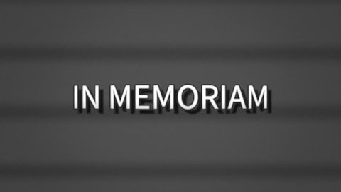 A sharp serious text, white letters on a grey background, appearing on a retro vintage TV screen with scanlines: In Memoriam (latin words, meaning In memory of a dead person).