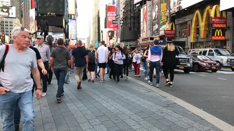 New York, New York / United States - 04 28 2017: New York 2017 People Crossing A Very Busy Intersection In Times Square New York