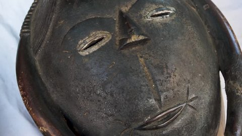 African wooden masks. They lie on the table. Masks are very old.