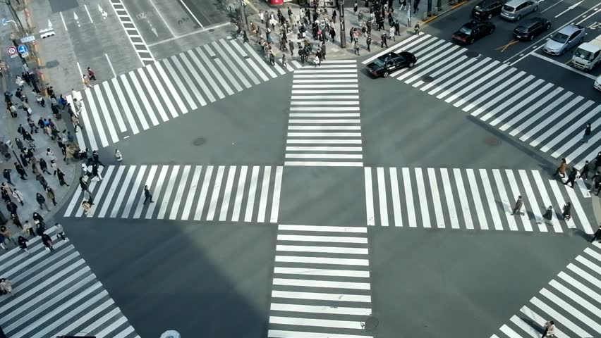 People passing the street crossing in Ginza district, Tokyo. Crosswalk. Intersection in Tokyo. | Shutterstock HD Video #1020608266