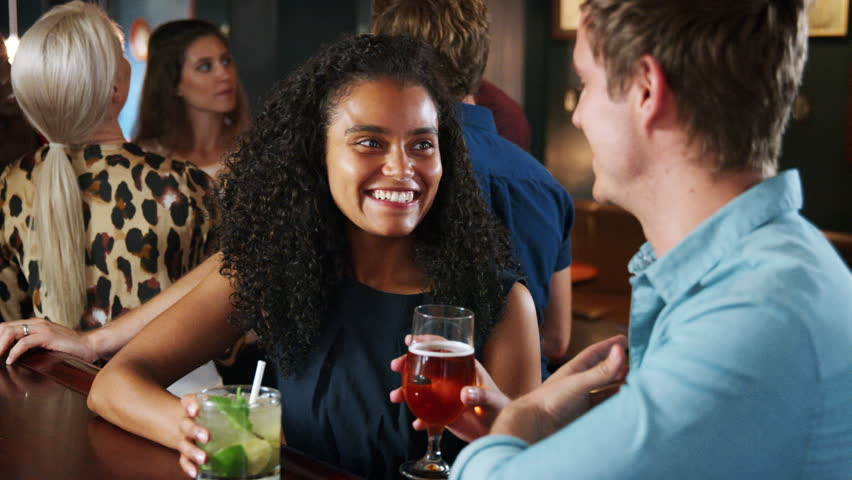 Young Couple On Date Meeting For Drinks In Cocktail Bar   Shutterstock HD Video #1020765316