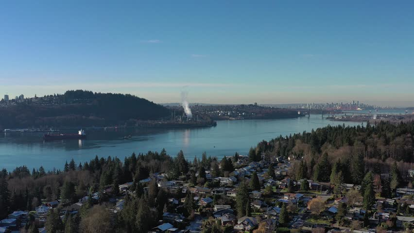 Aerial view over Burrard Inlet, ocean and island with boat and mountains in beautiful British Columbia. Canada. | Shutterstock HD Video #1020790426