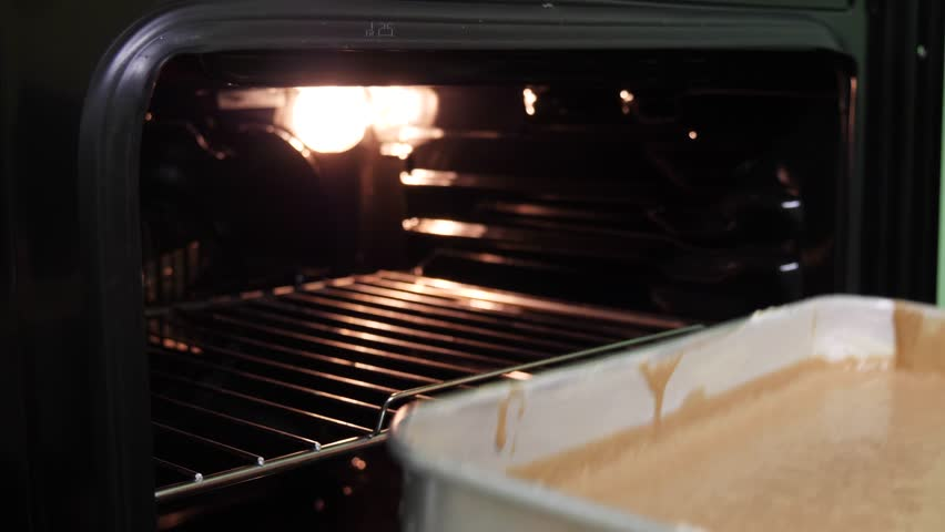 Put cake form in the oven to bake 4k | Shutterstock HD Video #1020843166