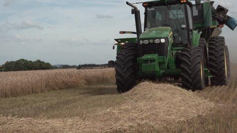 Castro, Brazil - 28 November 2018: Combine harvester John Deere at work in field of wheat