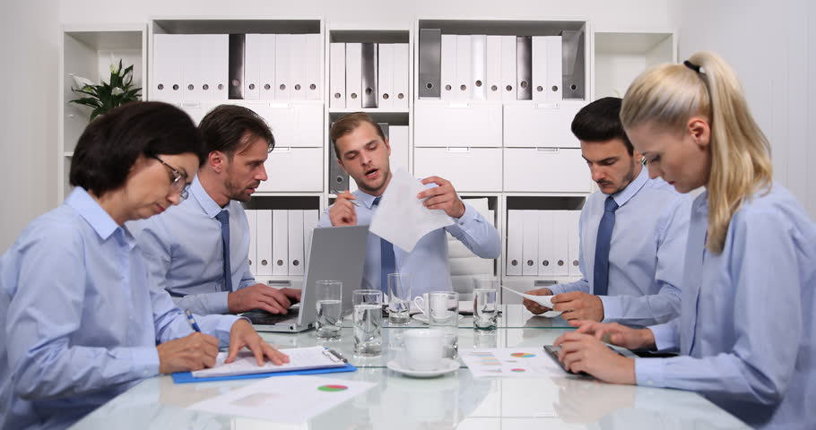 Team of Business Worker People Analyzing Pie Chart Reports Talking in Boardroom | Shutterstock HD Video #1020884086