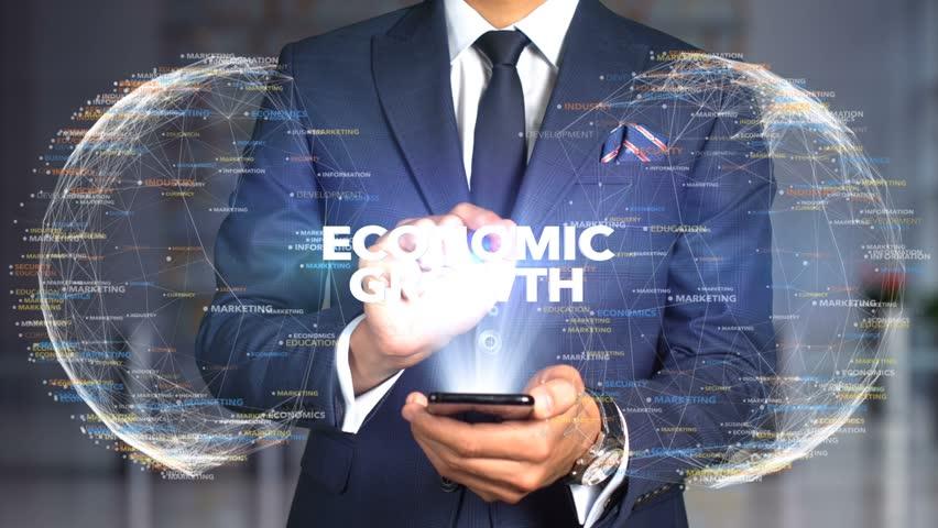 Businessman Hologram Concept Tech - ECONOMIC GROWTH   Shutterstock HD Video #1020897916