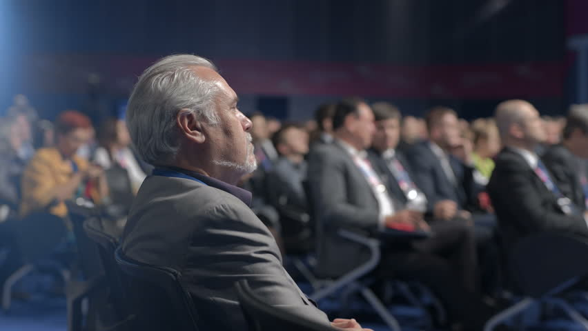 Novosibirsk Russia - 29 August 2018: Expert listeners view executive politician or corporation participant. Occupation at full summit room. Show of economic sale at crowded modern congress for manager | Shutterstock HD Video #1020954676