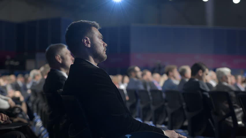 Crowded convention indoors marketing center place. Caucasian beautiful listener sitting on row of chairs. View workshop for bank company leadership. Information occupation for strategy of success sale | Shutterstock HD Video #1021001116