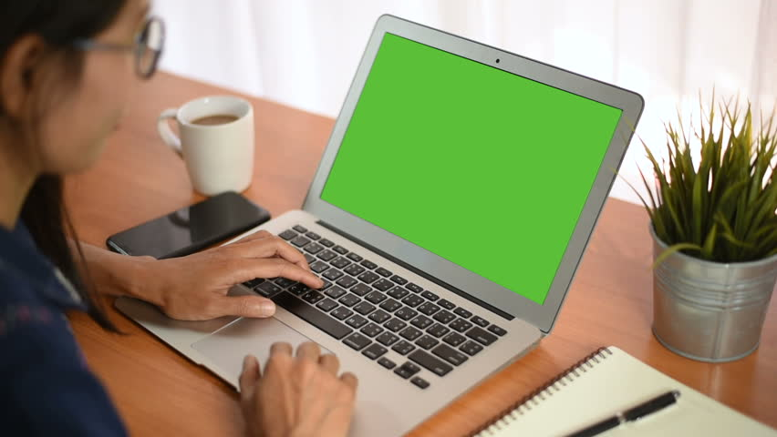 Young business start up, Young Owner Woman Start up for Business Online Working at home, Over the shoulder shot of a woman typing on a computer laptop with a key-green screen in home. | Shutterstock HD Video #1021001206