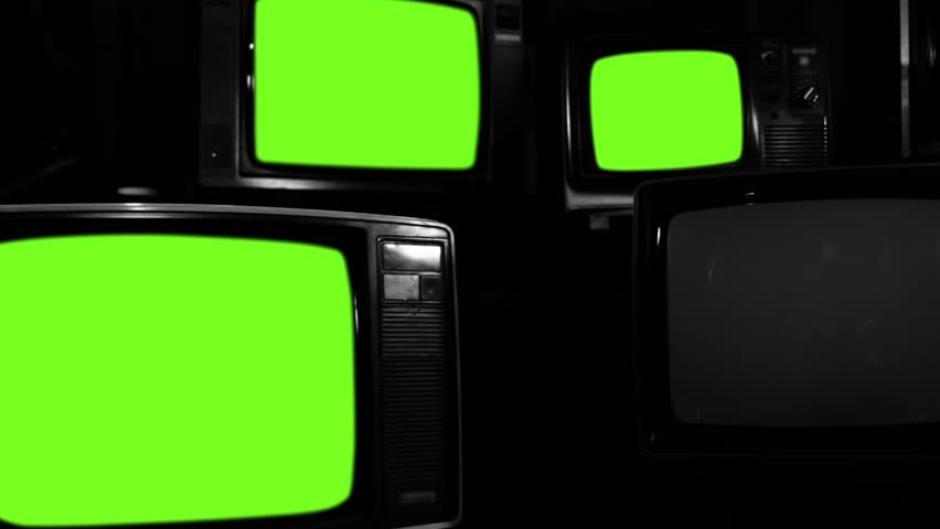 "Old Tvs Turning On Green Screen. Black and White Tone. Zoom Out. Ready to Replace Green Screens with any Footage or Picture you Want. You can do it with ""Keying"" (Chroma Key) effect. 