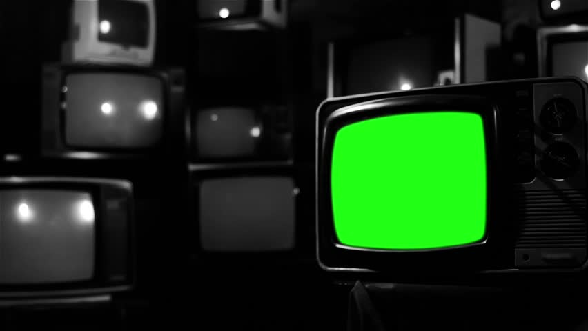 "Old Tv with Green Screen and many Old Tvs. Black and White Tone. Zoom Out. Ready to Replace Green Screen with any Footage or Picture you Want. You can do it with ""Keying"" (Chroma Key) effect. 