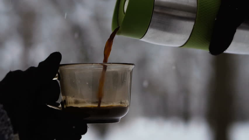 Coffee. Coffee and thermos on the background of the winter forest   Shutterstock HD Video #1021195096