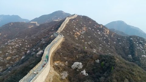 Aerial view of Great Wall of China during cold morning foggy day. Famous landmark Great Wall and mountains located in Badaling next to Beijing.