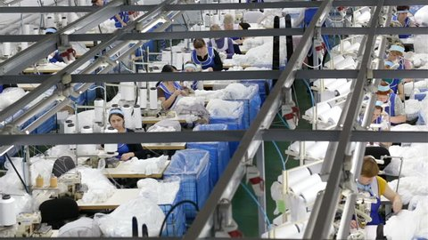 """Grodno, Belarus - November 21, 2017: The women's team works in one of the factories of JLLC """"CONTE SPA"""" for the production of women's tights. The enterprise is engaged in production of the wide range"""