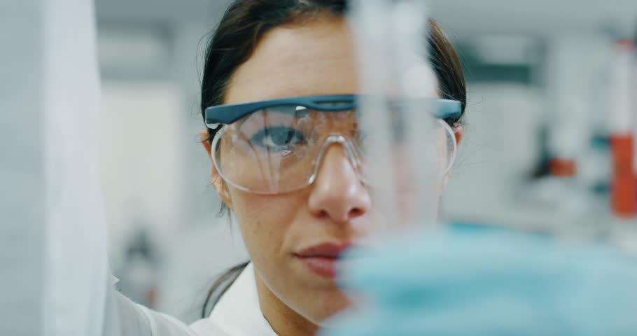 Portrait of female scientist with a pipette analyzes a liquid to extract the DNA and molecules in the test tubes in laboratory. Shot in 8K. Concept: research,biochemistry, pharmaceutical medicine | Shutterstock HD Video #1021305646