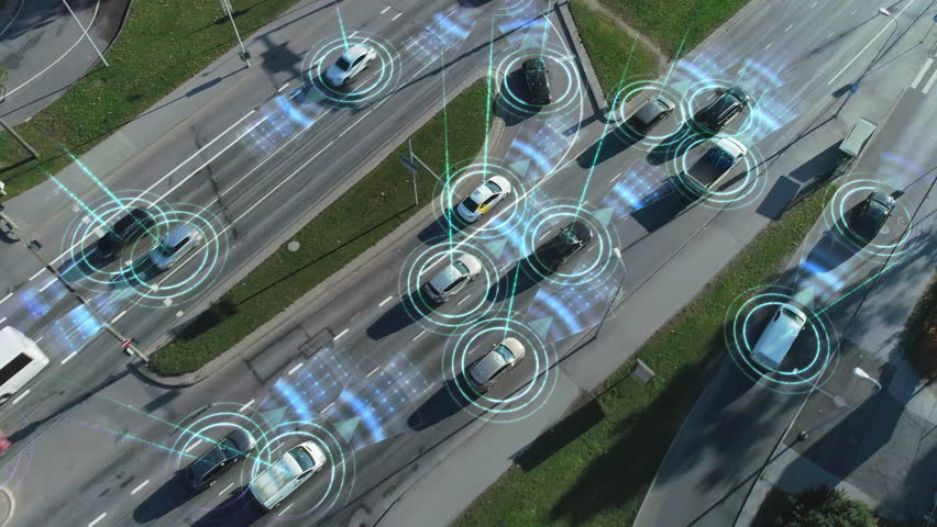 Aerial Drone View: White Autonomous Self Driving Car Moving Through City. Concept: Artificial Intelligence Scans Surrounding Environment, Detecting Cars, Avoids Traffic Jams and Drives Safely. | Shutterstock HD Video #1021307836