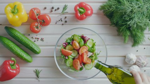 Preparation of vegetable salad in a salad bowl, flat lay