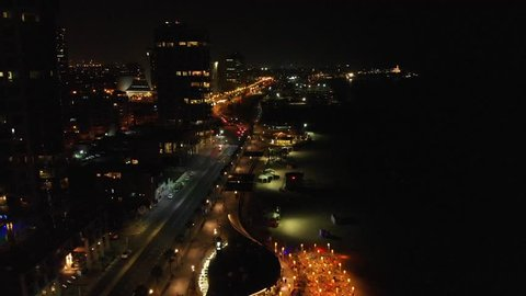 Night aerial view of Tel Aviv City with modern skylines and luxury hotels at the beach near the Tel Aviv port in Israel. Flying quadrocopter, drone over night tel Aviv