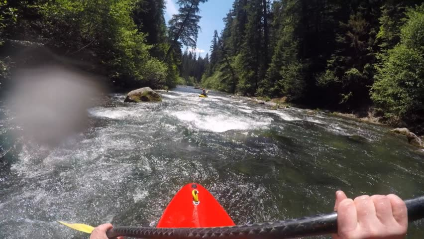 Whitewater kayaking on the Rogue River in Southern Oregon. Unique POV