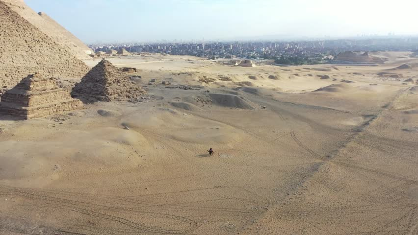 Aerial view of giza pyramids landscape. historical egypt pyramids shot by drone.   Shutterstock HD Video #1021470466