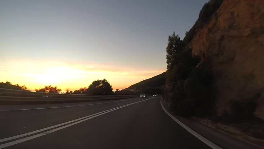 Driving at sunset on highway in Tuscany, Italy   Shutterstock HD Video #1021474066