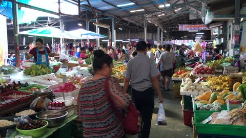 BANGKOK - DECEMBER 6, 2018: Unidentified people sell fruit, vegetables and other goods at a food market near the Don Mueang international airport.
