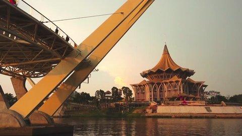 November 2018, Kuching, Sarawak. View of Sarawak State Legislative Building by the river with Darul Hana Bridge