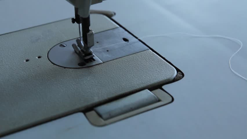 Sewing machine with a thread | Shutterstock HD Video #1021506466