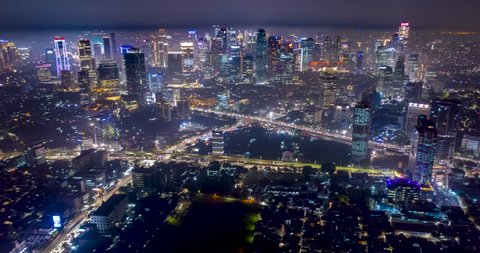JAKARTA, Indonesia - December 20, 2018: Beautiful aerial hyperlapse of nighttime in Jakarta downtown with night lights and skyscrapers view. Shot in 4k resolution
