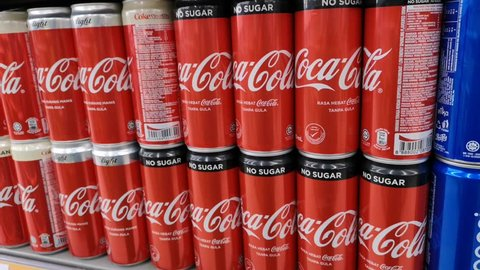Putrajaya, Malaysia - 25 December 2018 : Close up a Coca Cola can drink on display in a grocery store. Coca Cola Company is leading manufacturer of soda drinks in the world.