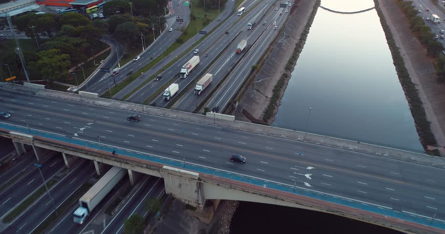 Aerial view of cars, bus and trucks on highway in Sao Paulo city, Brazil. Great traffic scene. Fantastic landscape. Business. Highway, Business place. | Shutterstock HD Video #1021536376
