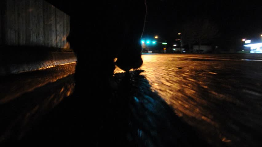 Walking alone down the street at night - low camera angle