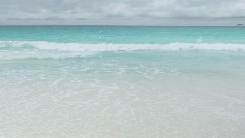 View waves break on island tropical  beach. Sea waves on the beautiful island Maldives | Shutterstock HD Video #1021561666