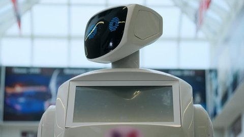 Close up of robot head. Robots emotions. The robot looking at camera at person. robots Modern Robotic Technologies. Modern Robotic Technologies. love. heart. artificial intelligence, virtual, vr 4 k