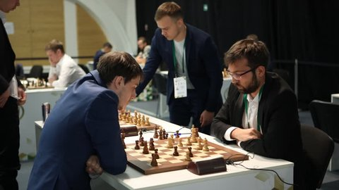 ST. PETERSBURG, RUSSIA - DECEMBER 27, 2018: Men compete during second day of King Salman World Rapid Chess Championship 2018 Open. 206 athletes take part in the competition