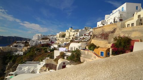 Picturesque cliffside town of Oia on the mediterranean island of  Santorini, Greece, slow motion