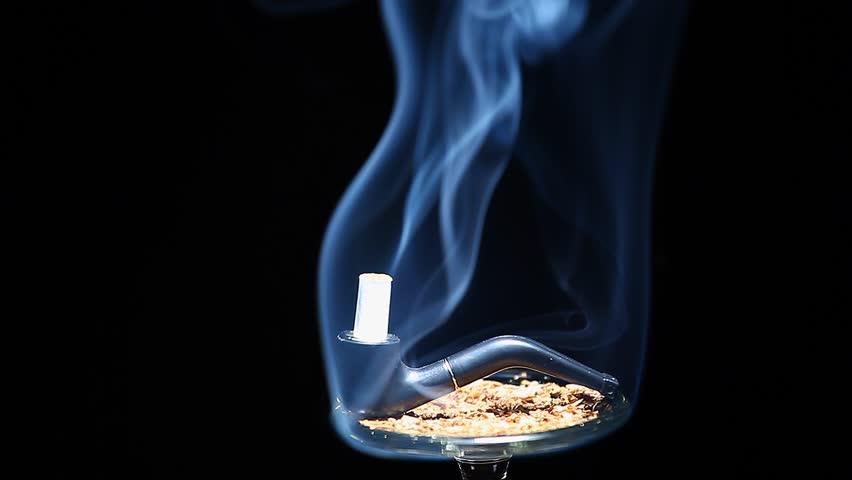 Black smoking pipe    Shutterstock HD Video #1021938196