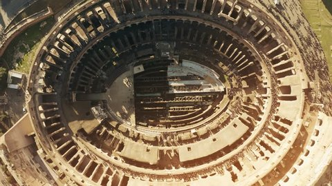 Aerial top down hyperlapse of crowded Colosseum or Coliseum amphitheatre in Rome, main landmark of the city and Italy