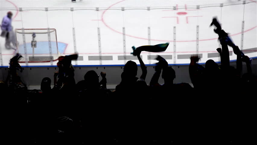 Silhouettes of fans rejoice at a goal in hockey. | Shutterstock HD Video #1022052736